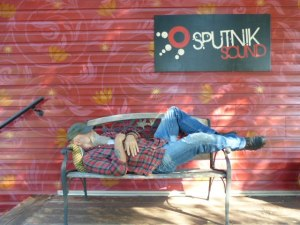 Seasick Steve sleeping on a bench